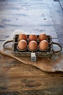 RUSTIC RATTAN EGG HOLDER